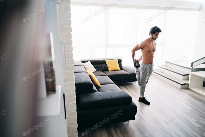 Adult Man Fitness Training At Home Stretching Muscles Before Workout