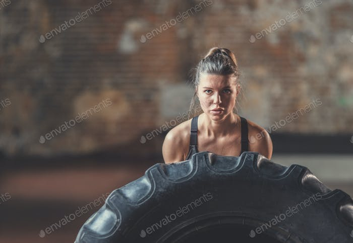 Young girl with a crossfit wheel