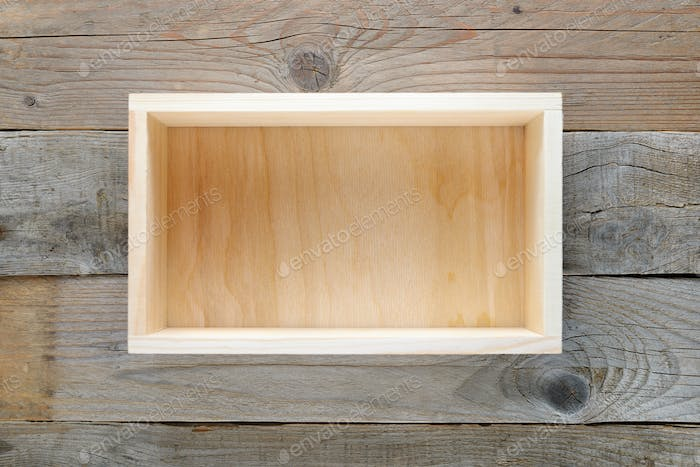 Empty wooden box on wooden background top view
