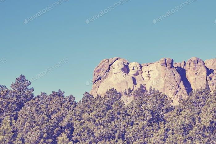 Retro color toned Mount Rushmore National Memorial, USA.