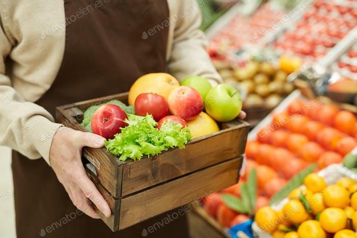 Man Holding Box of Fresh Fruit