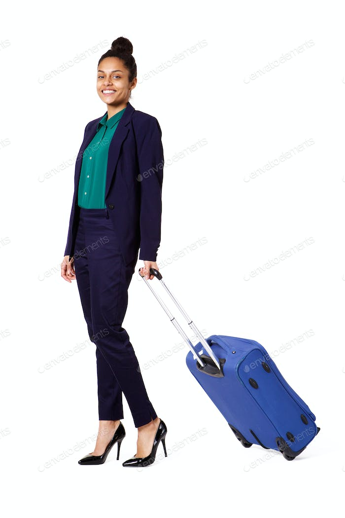Businesswoman walking with travel bag