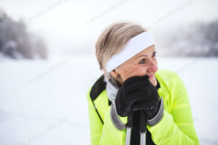 Senior woman skiing.