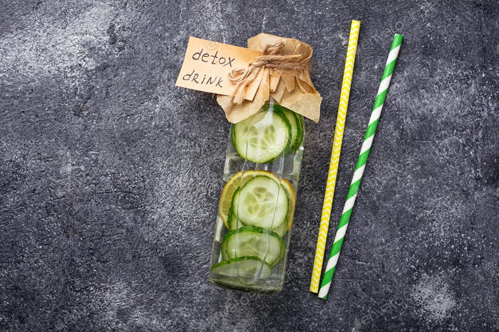 Bottle of fresh detox drink with cucumber and lemon