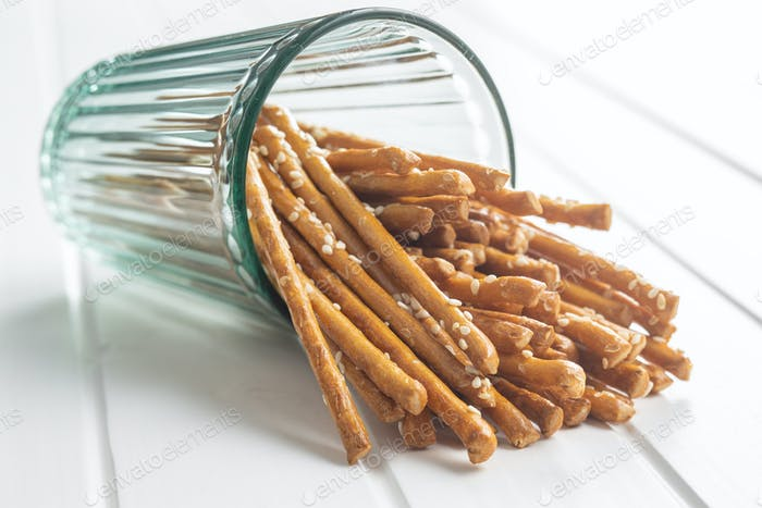 Salty sticks. Crunchy pretzels in glass.