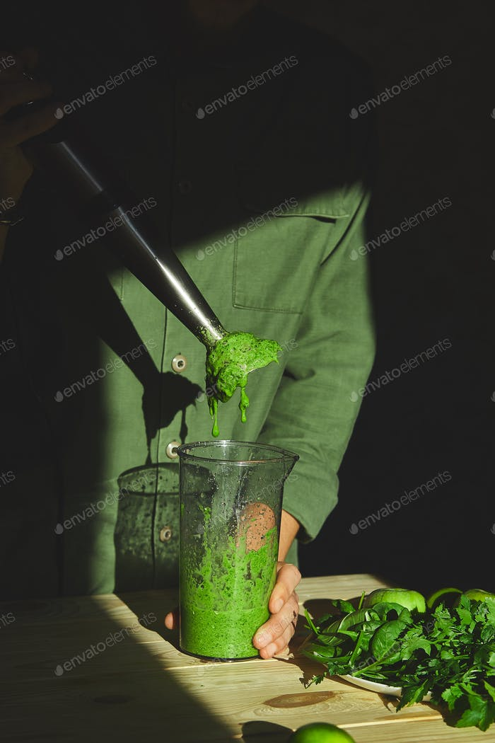 Process of preparing green detox smoothie with blender