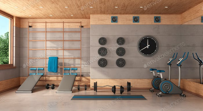 Home gym in a concrete and wooden room