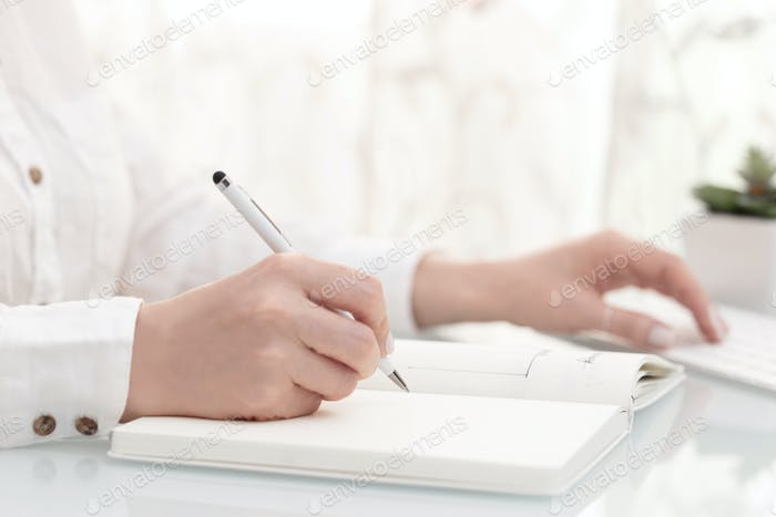 Doctor or businesss woman writing
