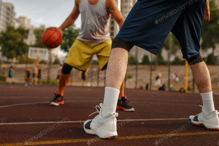 Two players in the center of basketball field