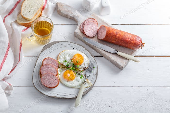 Eggs and sausage for breakfast, top view, copy space