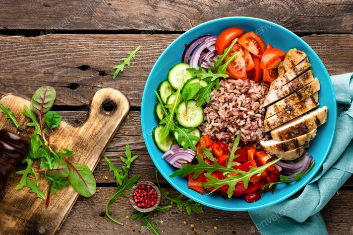 Grilled chicken brest, rice and fresh vgetable salad