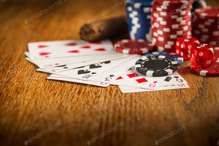 Cigar, chips for gamblings, drink and playing cards