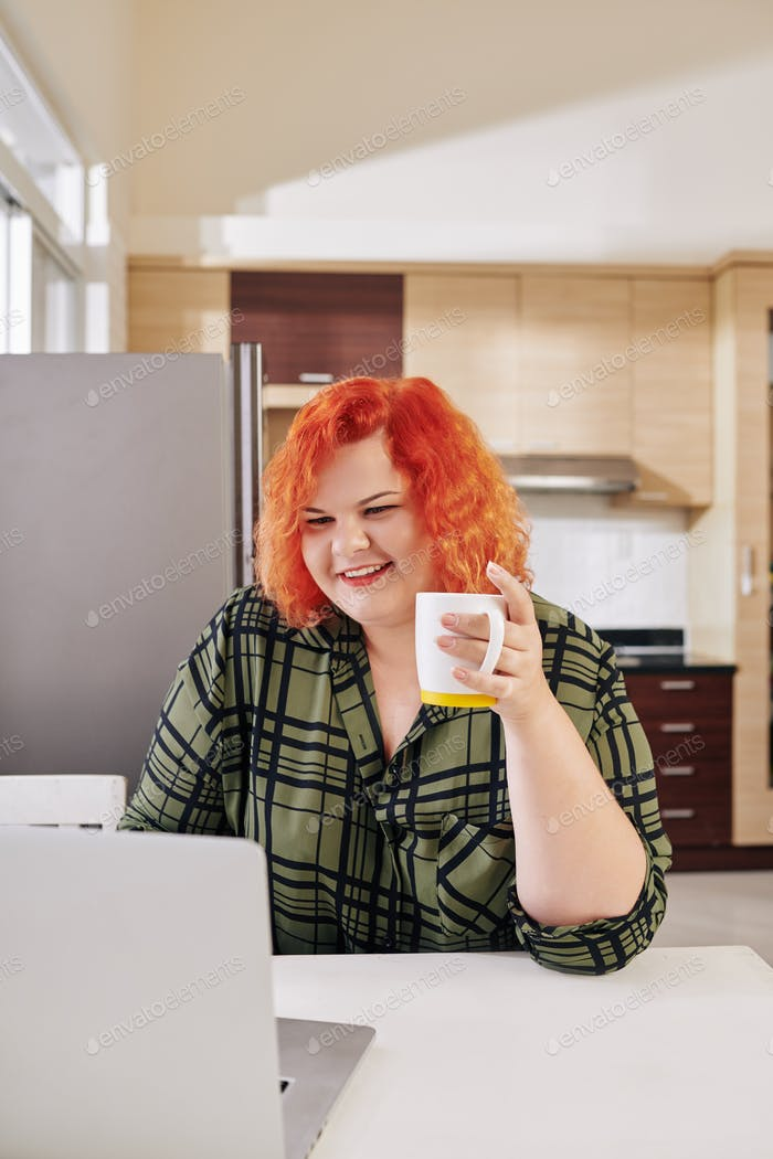 Overweight woman drinking morning coffee