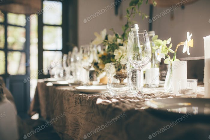 Birthday. Wedding banquet. Table for guests, decorated with candles and flowers