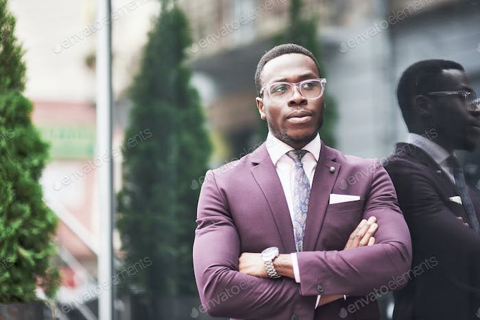 A beautiful young African American who thinks about a serious idea. Confident in making business