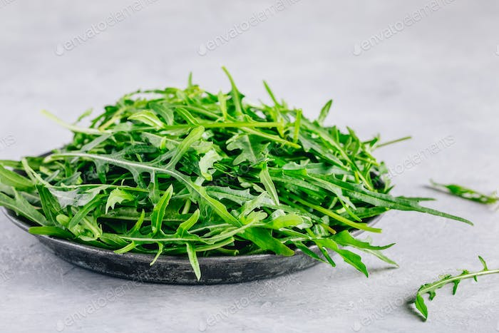 Fresh organic green leaves of arugula, ingredient for healthy salad