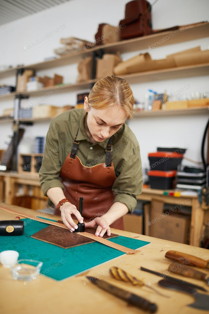 Woman Making Leather Belt