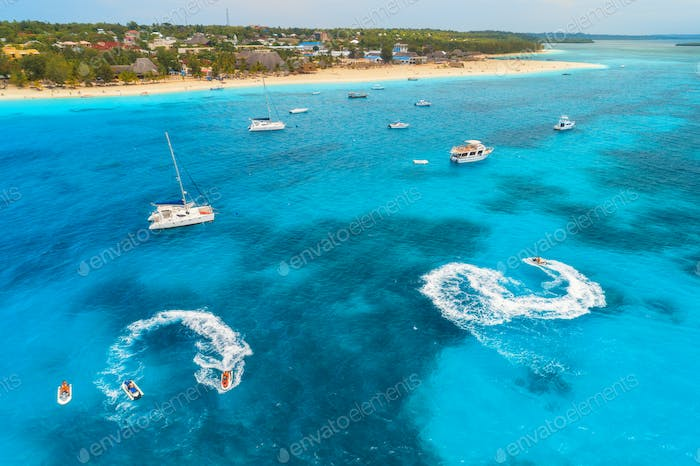 Aerial view of boats and floating water scooter in blue sea