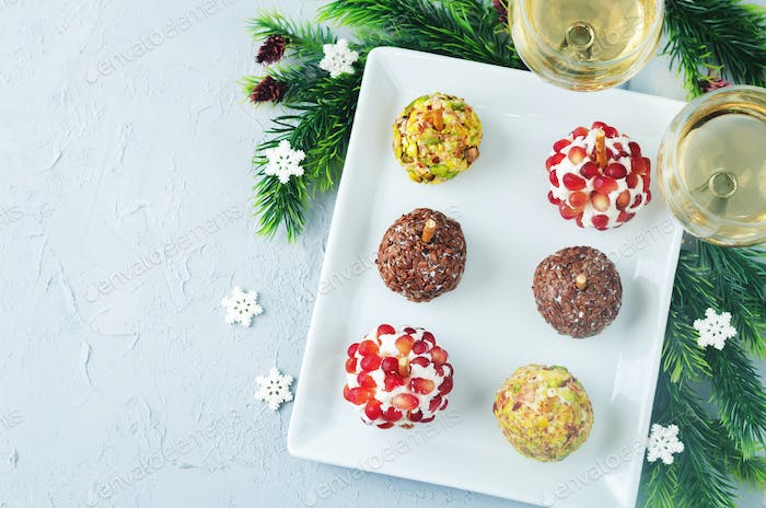 Variation of goat cheese balls appetizer with pistachio, pomegra
