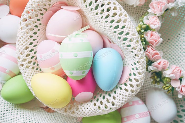 A beautiful and colorful close-up flat of easter eggs in plain c