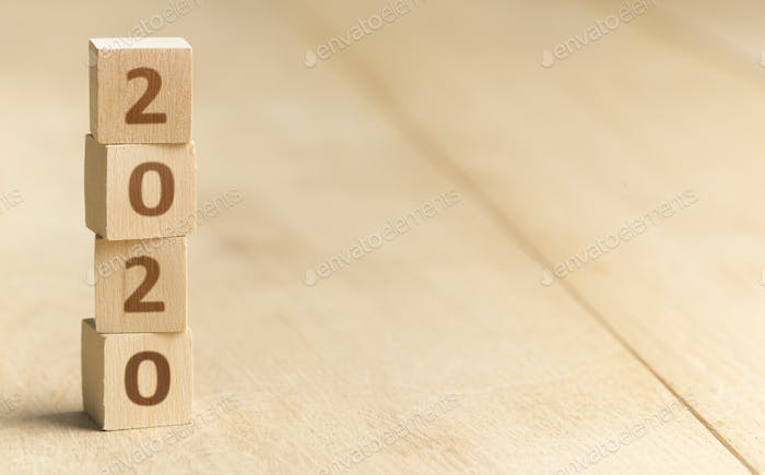 Wooden blocks with 2020 numbers standing on the floor