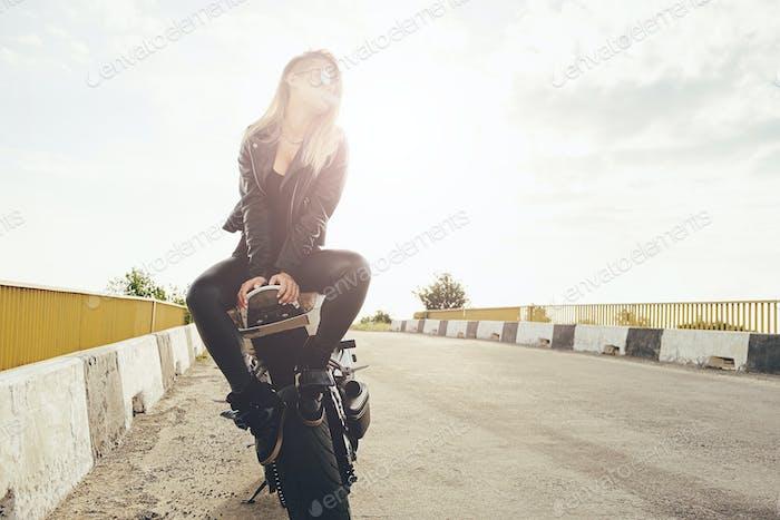 Beautiful biker women enjoying freedom