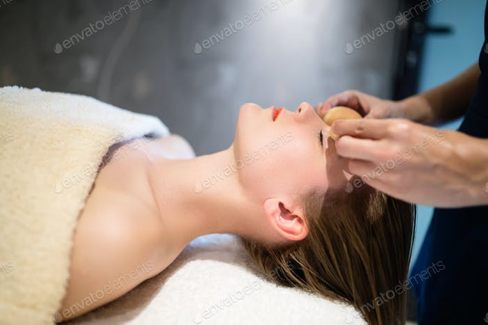 Rejuvenating relaxing massage by masseur