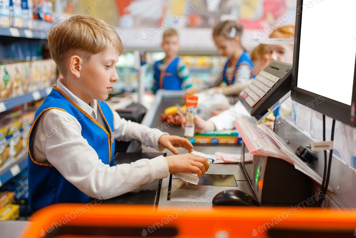 Boy in uniform at the register playing salesman