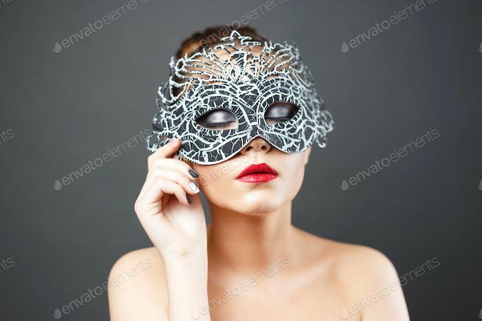 fashion photo of beautiful sexy girl in mask