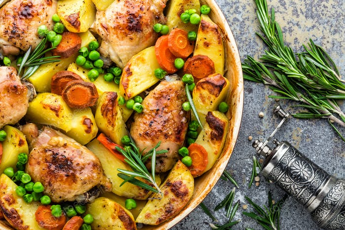 Chicken meat, thighs baked with potato, carrot and green peas