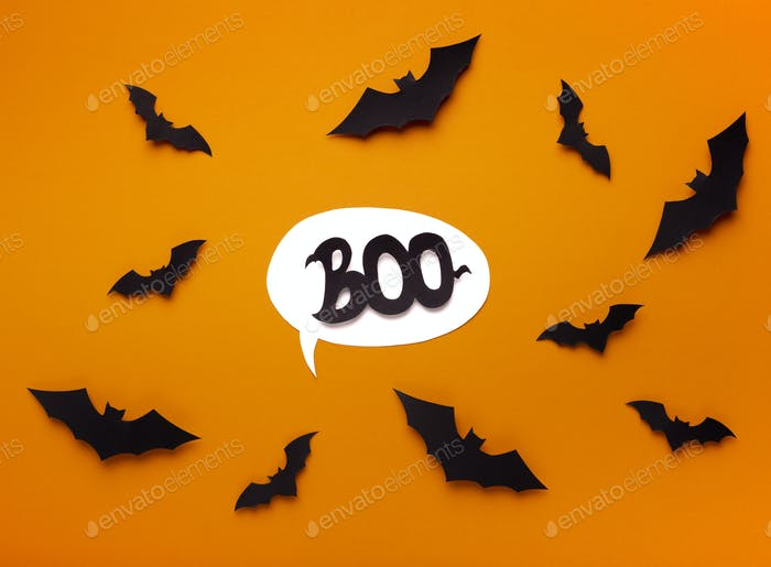 Speech bubble with boo text on scaring background