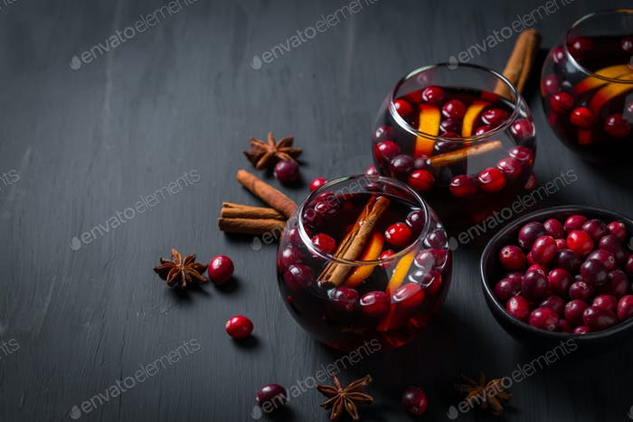 Mulled wine with orange, cranberries and cinnamon and anise