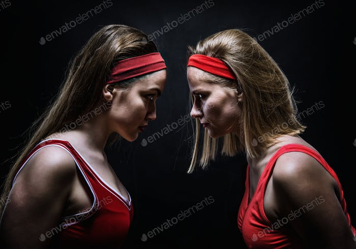 Two female boxers standing face to face