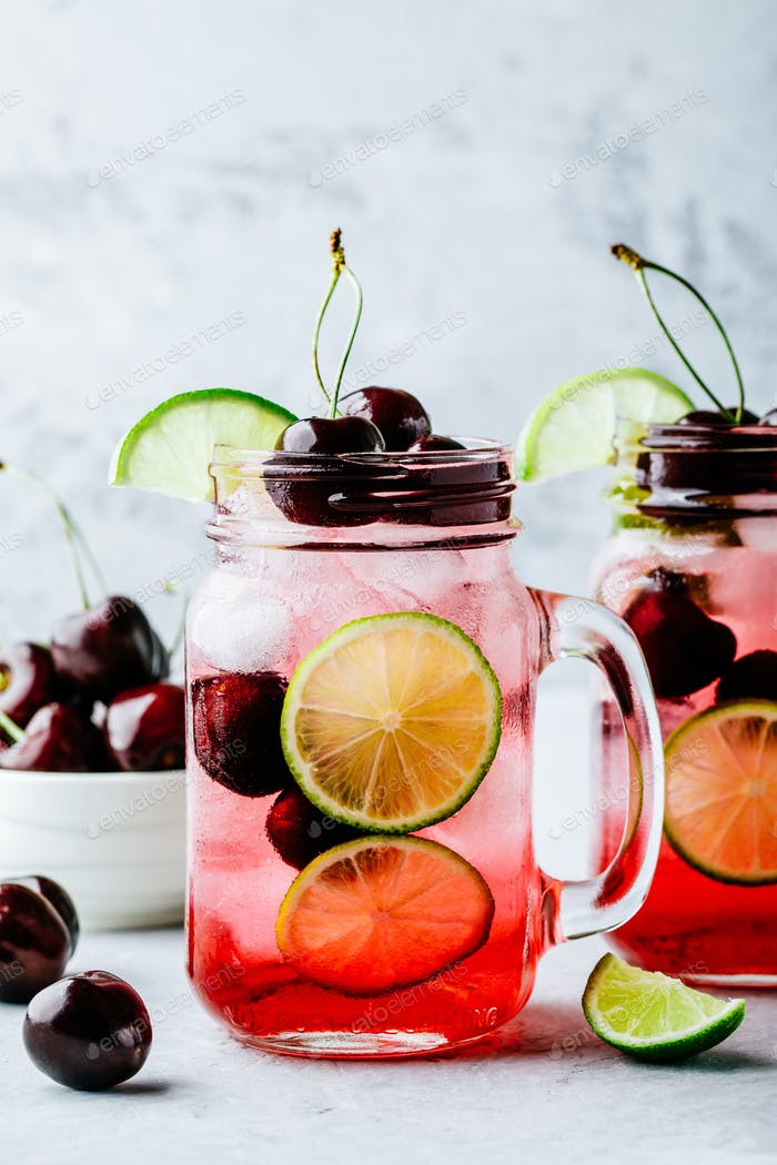 Cherry Limeade or Lemonade in glass mason jar. Ice cold summer drink.