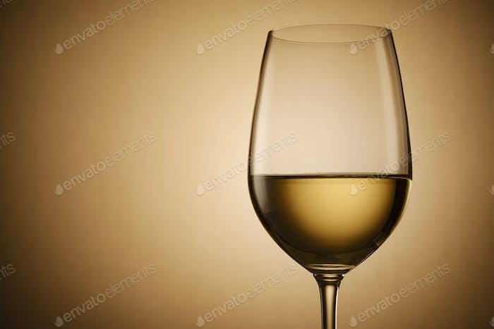 Glass of white wine over a graduated background