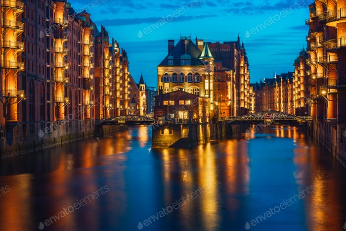 Hamburg city old port in blue hour, Germany, Europe. Historical famous warehouse district with