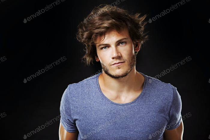 caucasian man wearing  blue tshirt and trendy hairstyle