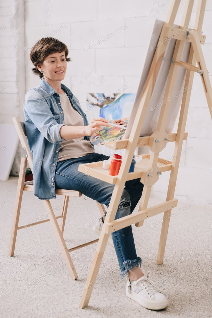Female Artist Painting at Easel