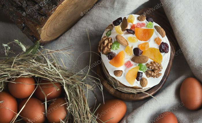 Easter cake with dried fruits and eggs top view