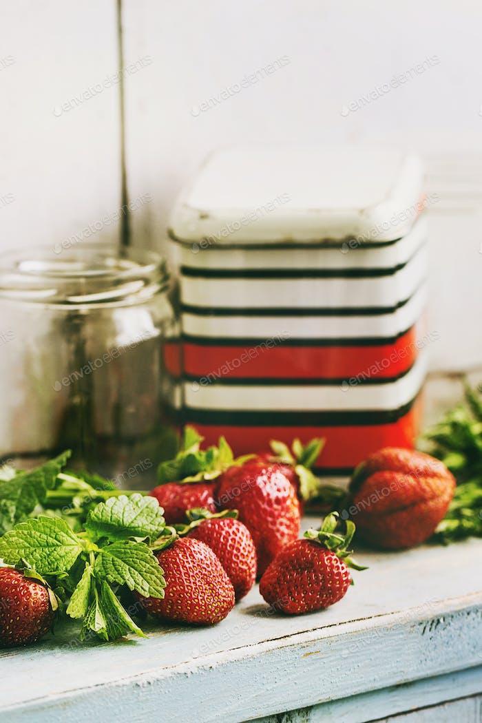 Fresh strawberries and melissa herbs