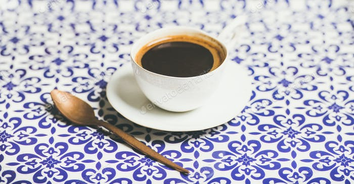 Cup of black Turkish or Eastern style coffee, selective focus
