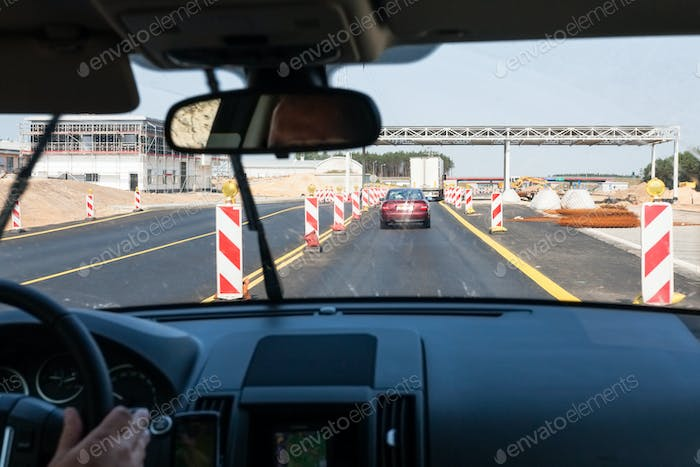 driving car along repairing area on Autostrada A2
