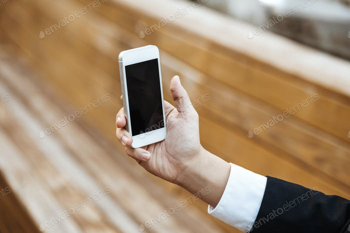 Business Concept - Young Business man check mobile phone for meeting