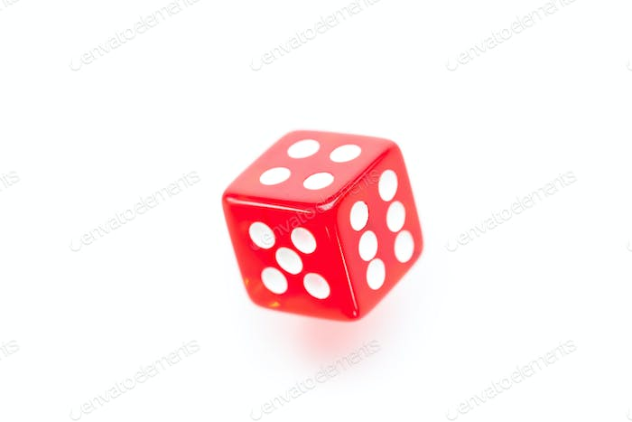 Red dice moving against a white background