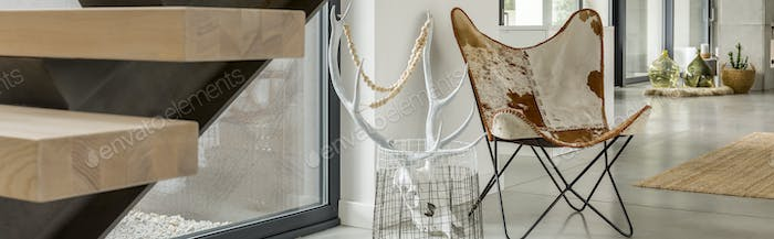 LEather chair and antlers