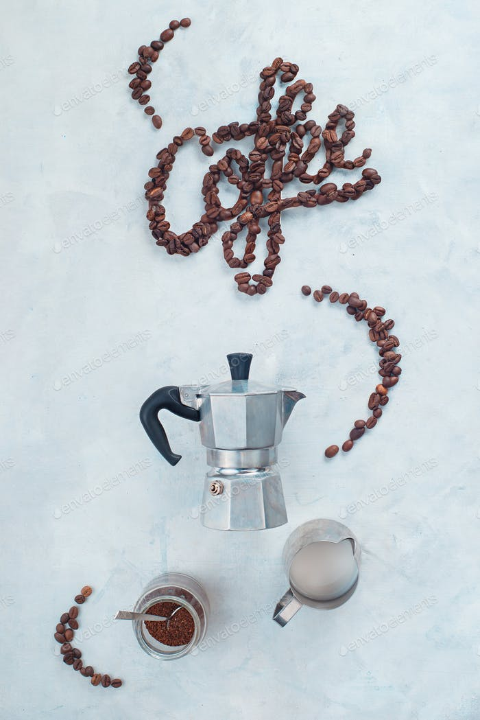 Minimalist flatlay with food typography. Word Coffee made with coffee beans