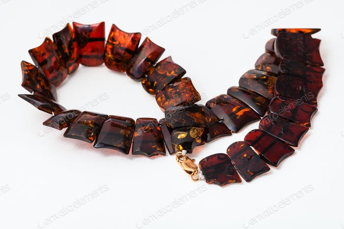 coiled necklace from polished amber flat pieces