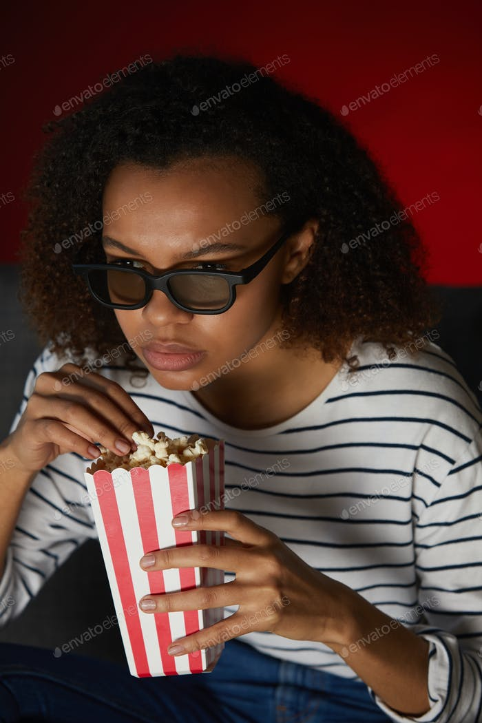 African-American Girl Watching 3D Movie
