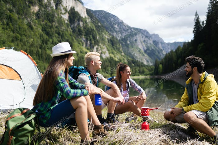 Trekking, camping, hiking and wild life concept. Group of friends are hiking in nature