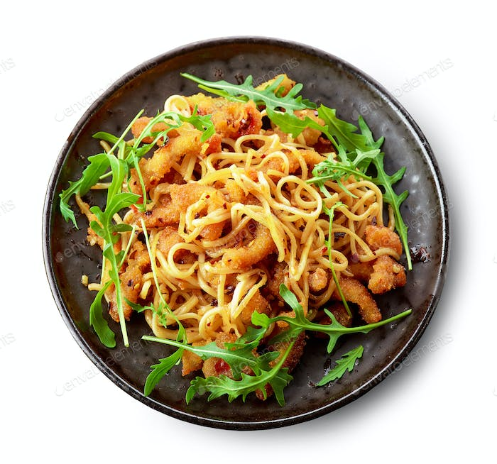 Plate of asian noodles with fried meat